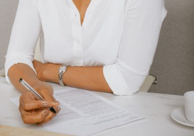 black woman signing contract