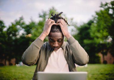 anxious man looking at computer