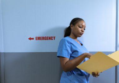 black nurse looking in file
